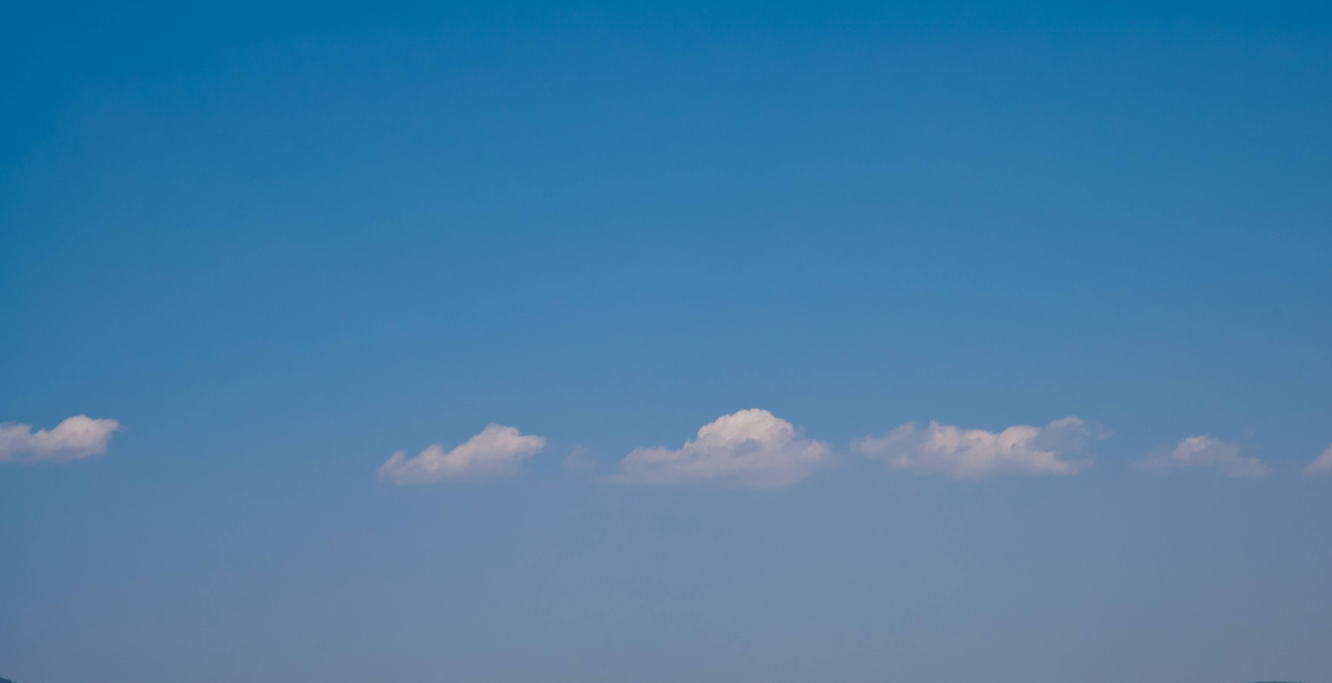 Blue sky and a cloudy line background