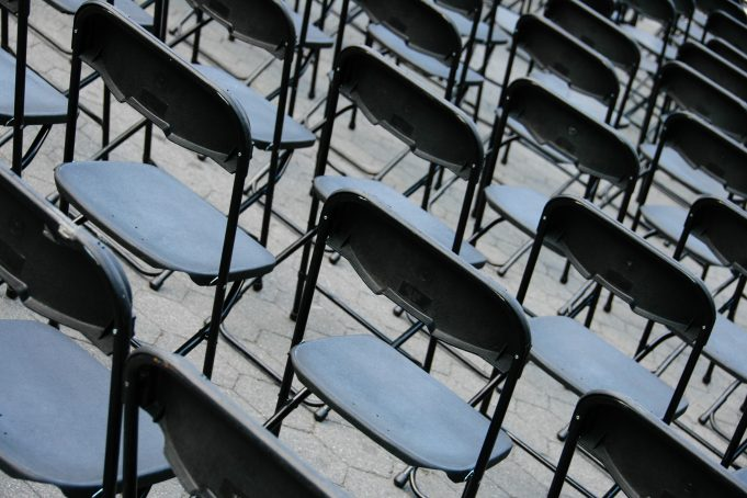 Black Plastic Chairs Framed in Diagonal View