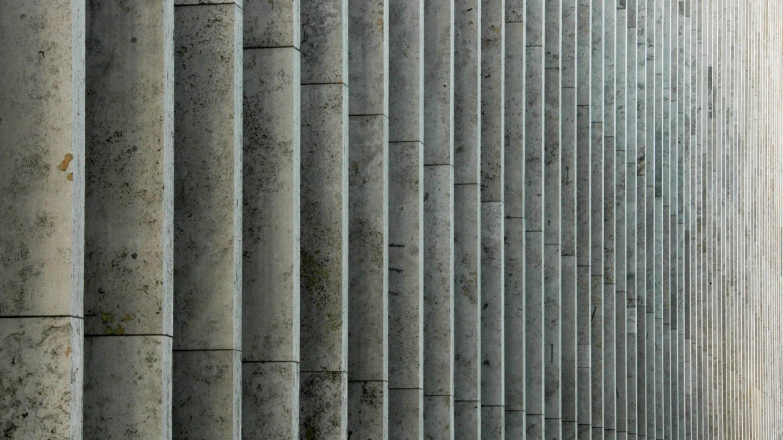 Stone pilars wall background