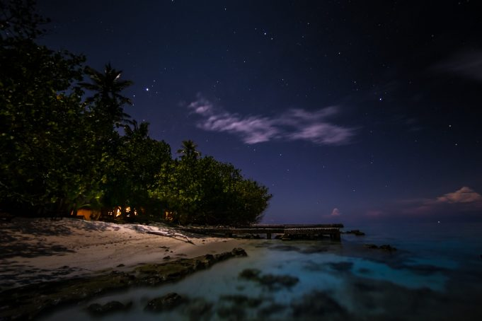 Tropical island by night Makunudu Indian Ocean Maldives
