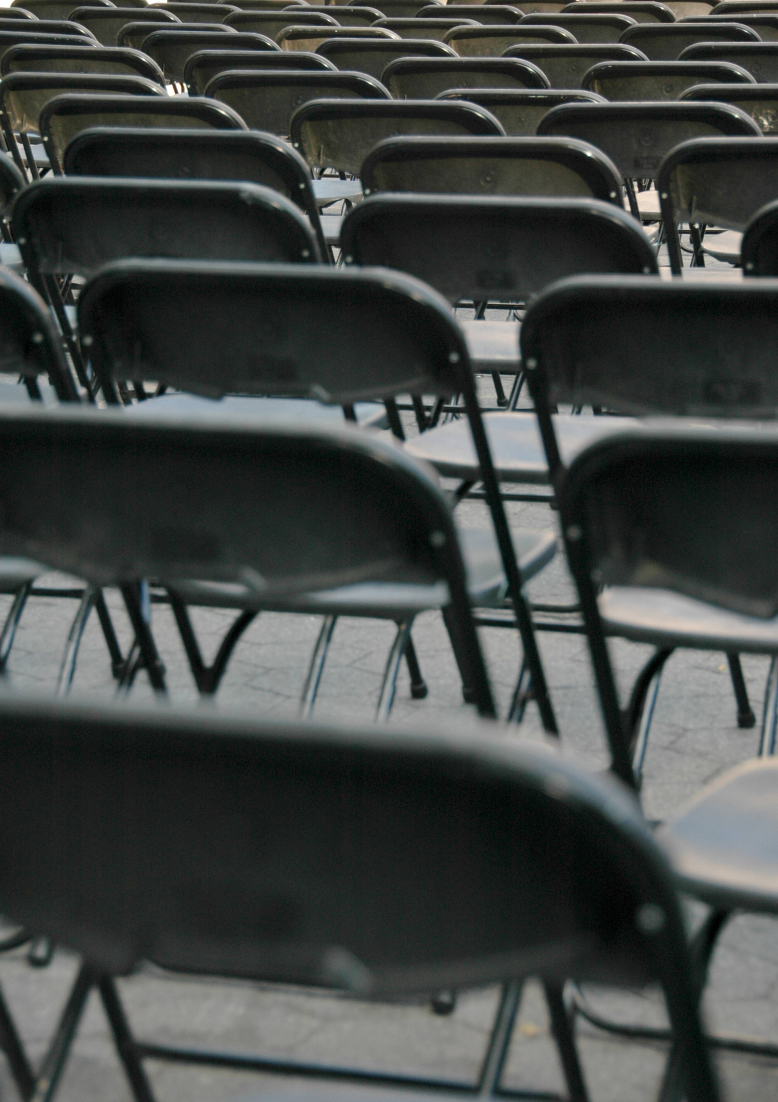 Pattern of Empty Black Folding Chairs