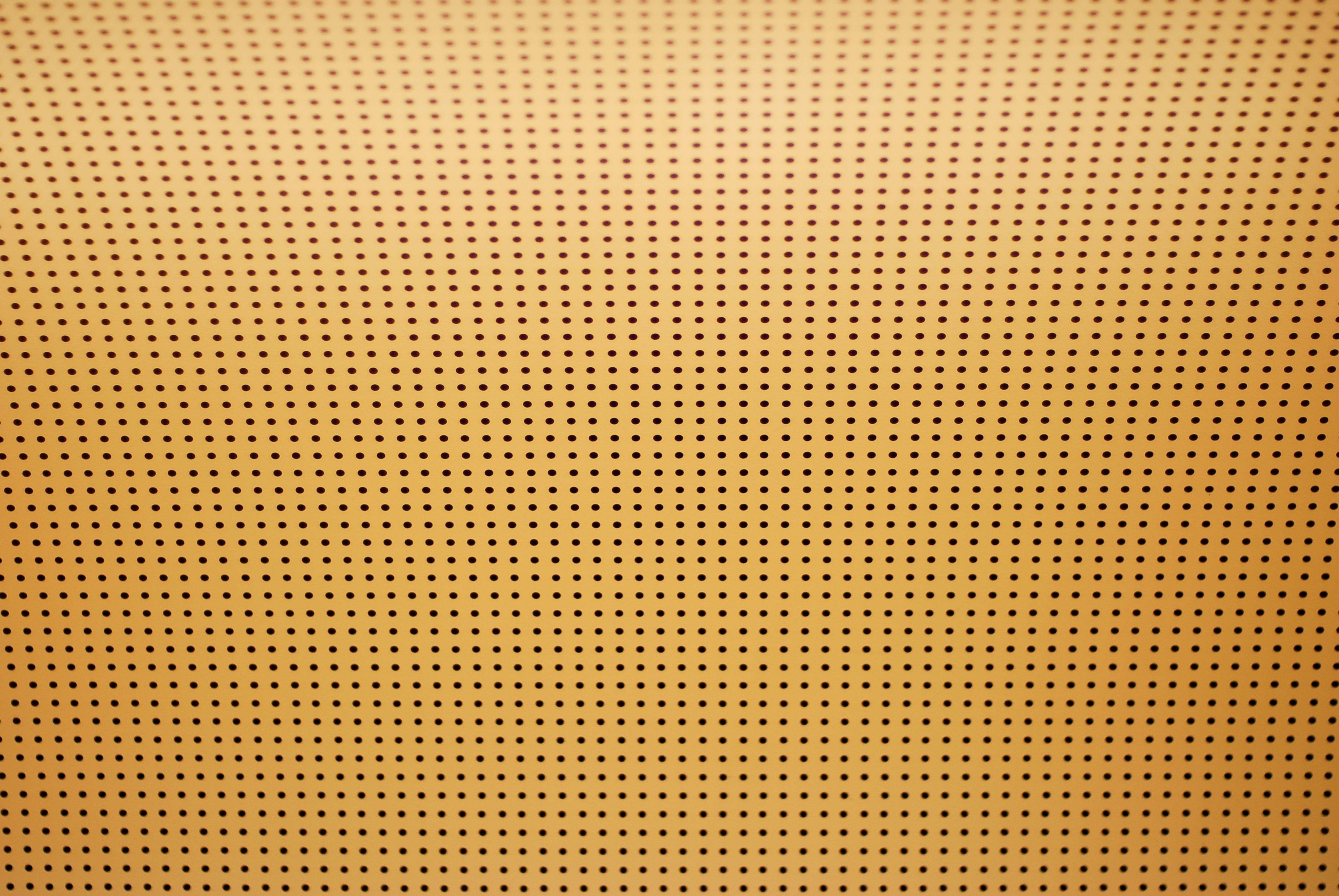 Perforated ceiling yellow background