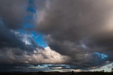 Heavy dark clouds on a blue sky