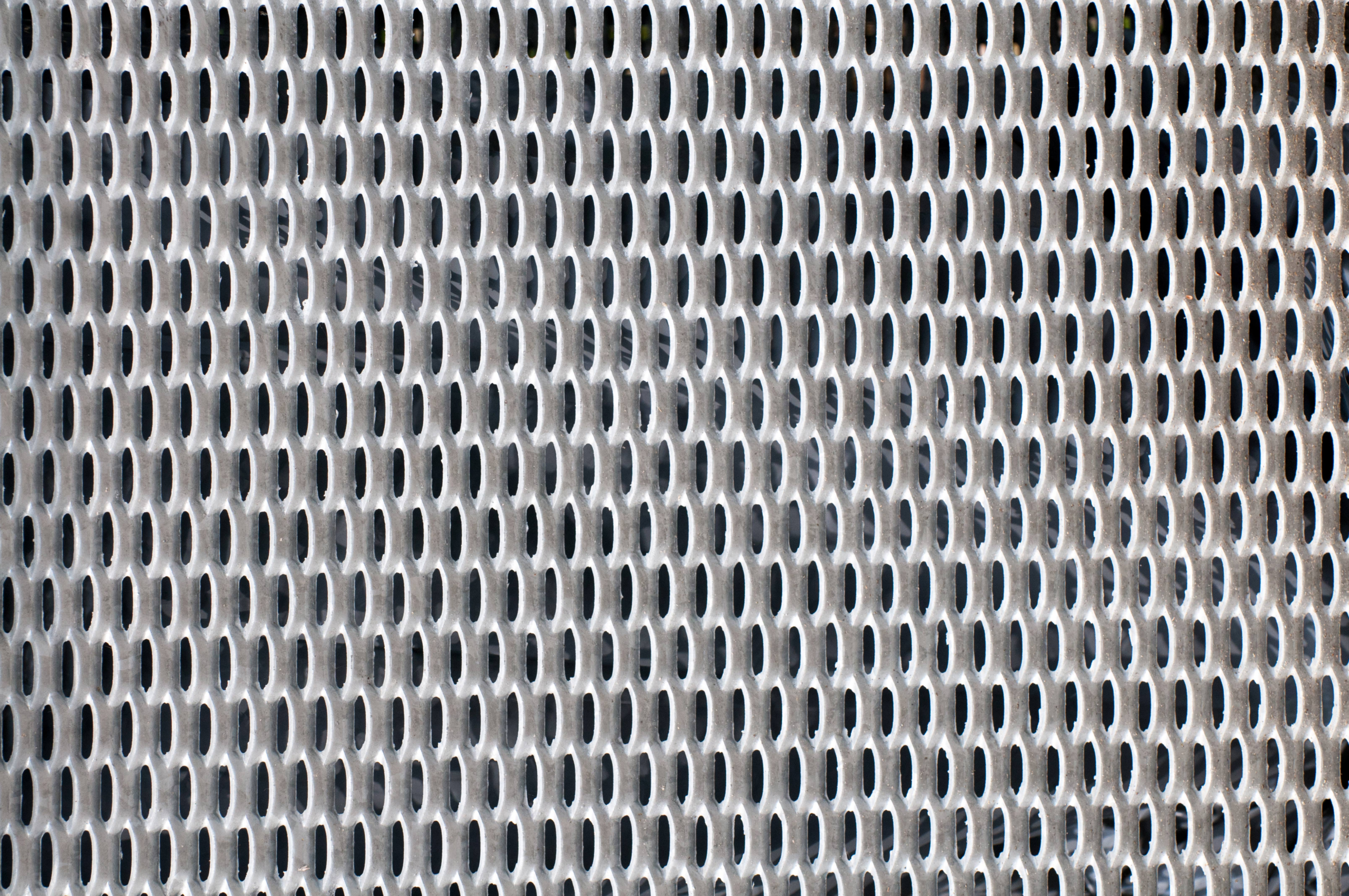 Perforated metal mesh close-up pattern