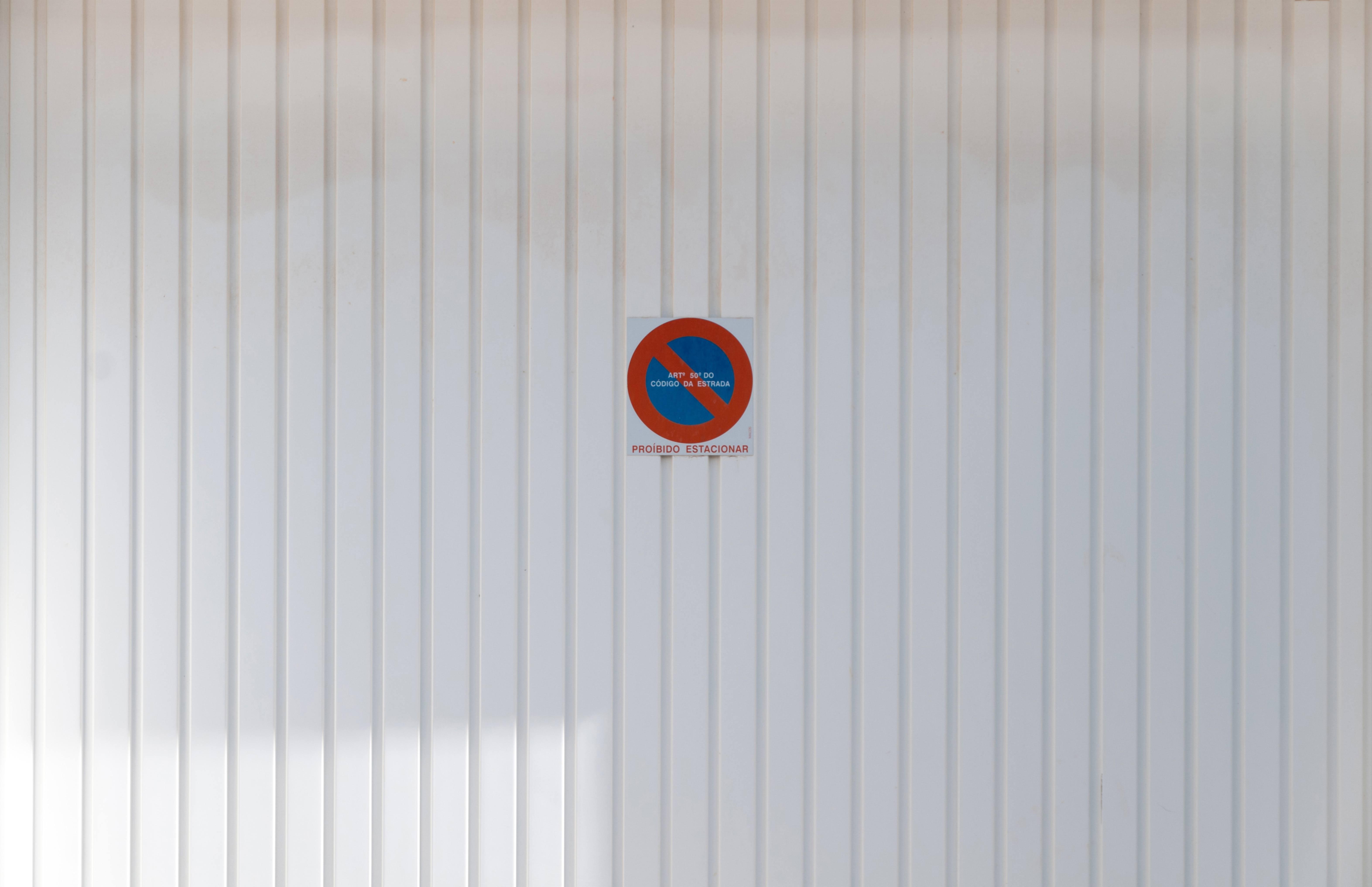 Proibido Estacionar White Metal Garage Door