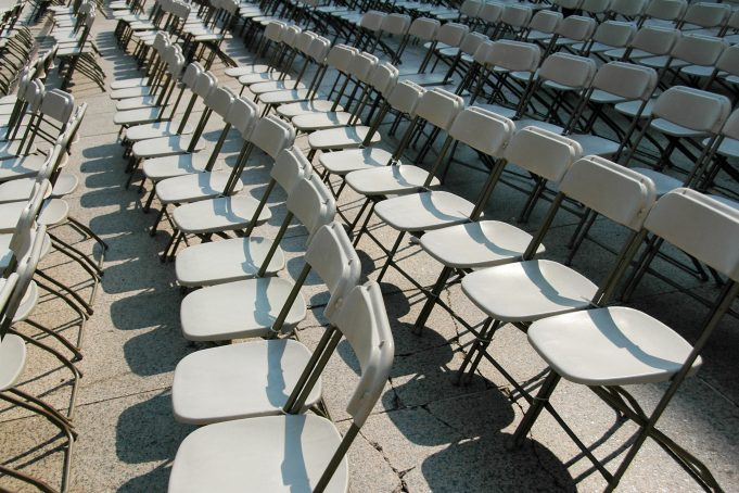 Rows of white folding chairs New York