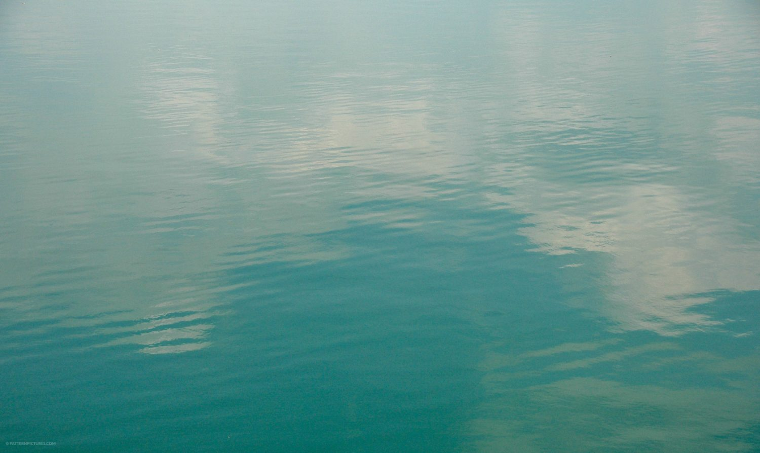 Sea water texture clouds reflection