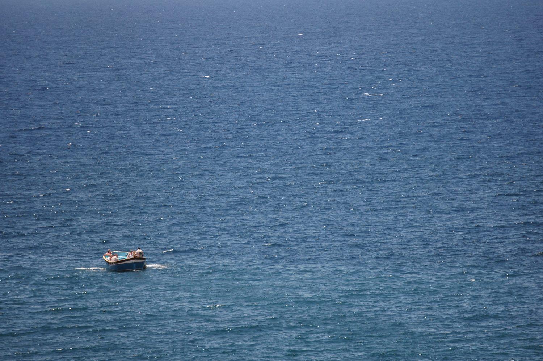 Small pleasure boat sailing at sea