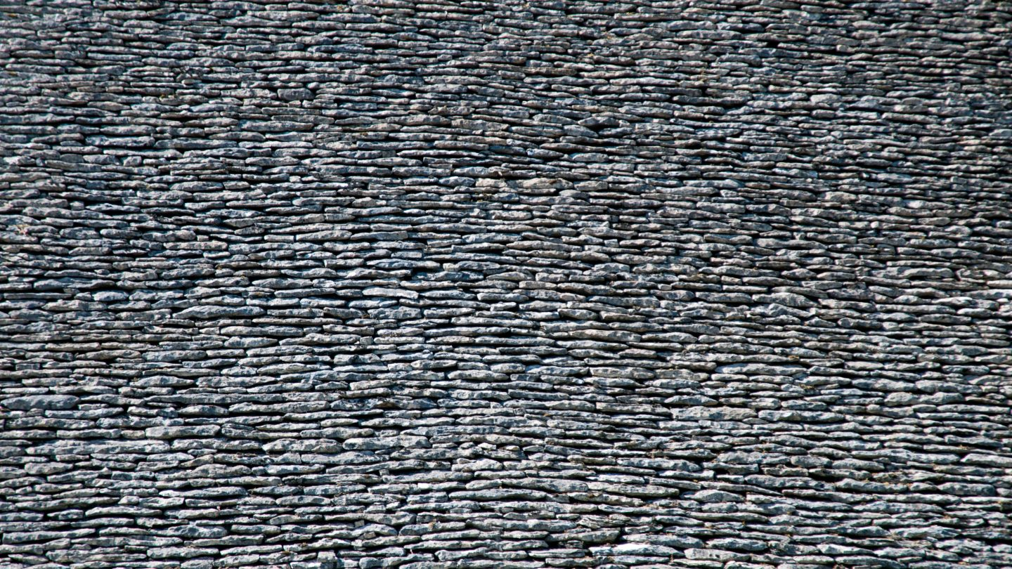 Stacked stone roof tiles texture