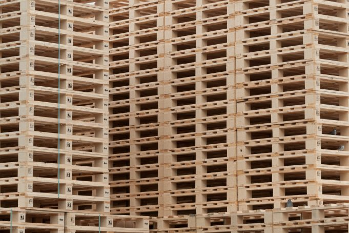 Stacked wooden pallets at a pallet storage