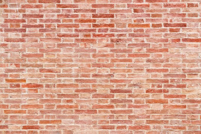 Stone red brick wall background