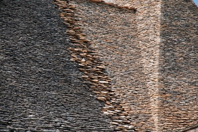 Stone stacked bricked layers roof background