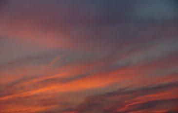 Striped Orange Glowing Cloudy Sunset