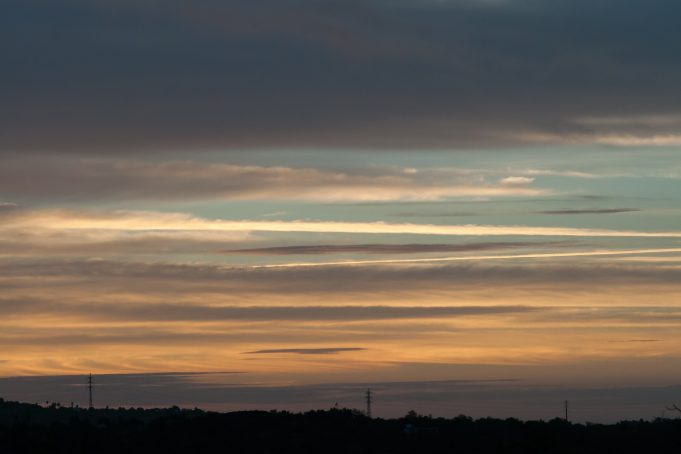 Striped thin clouds sunset sky