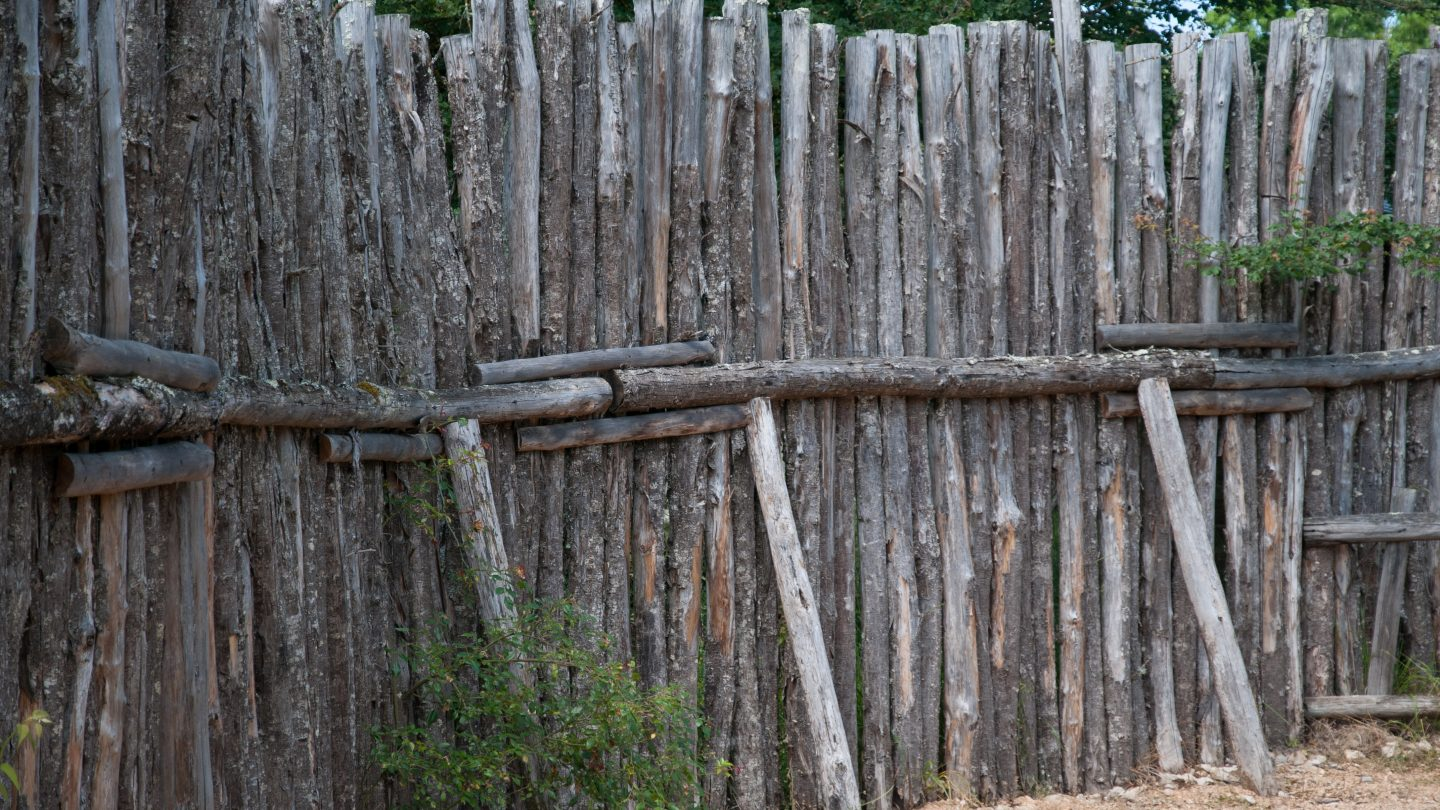 Studded wooden fence wall