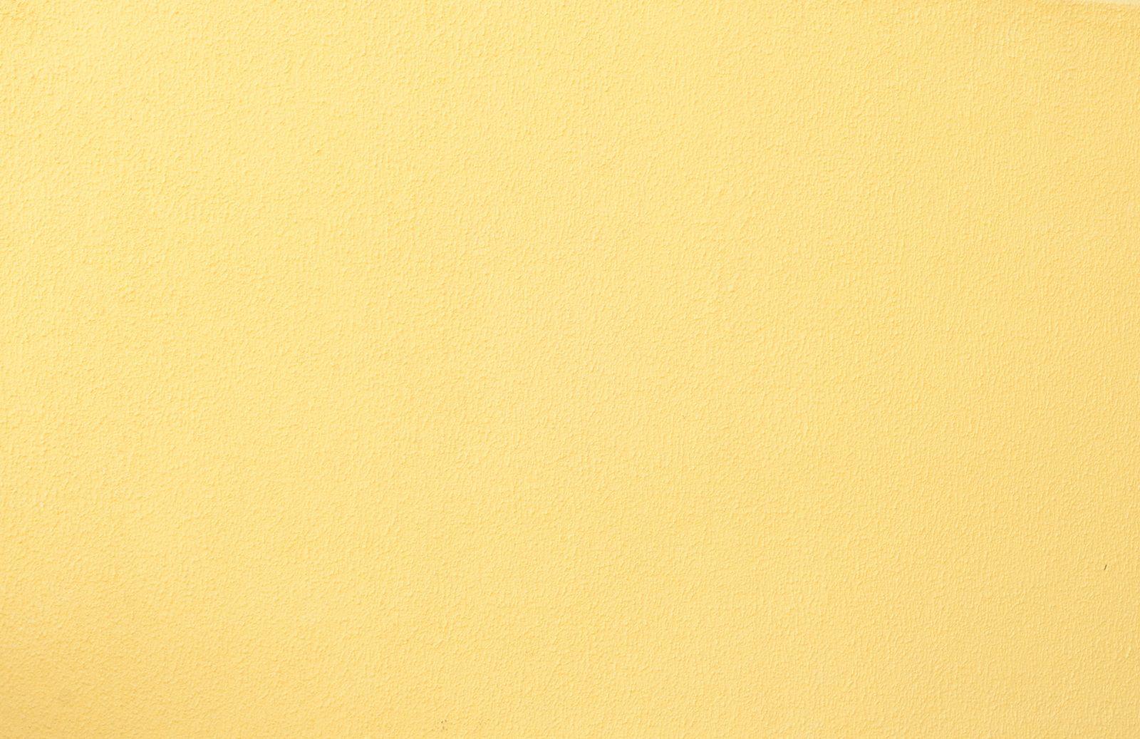 Subtle plaster concrete yellow wall