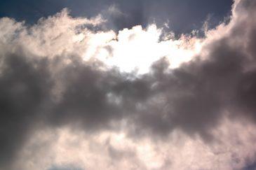 Sunburst behind the dark clouds