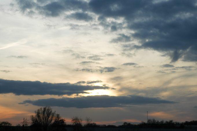 Sunrise glow and grey sky