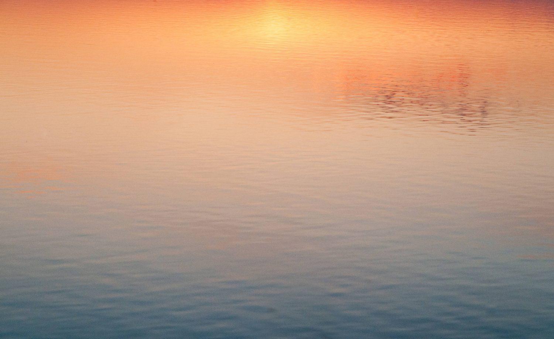 Sunset water reflection golden hour light