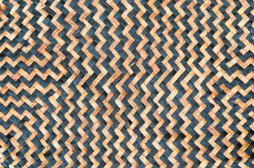 Tan woven leaf mat with black zig zag pattern