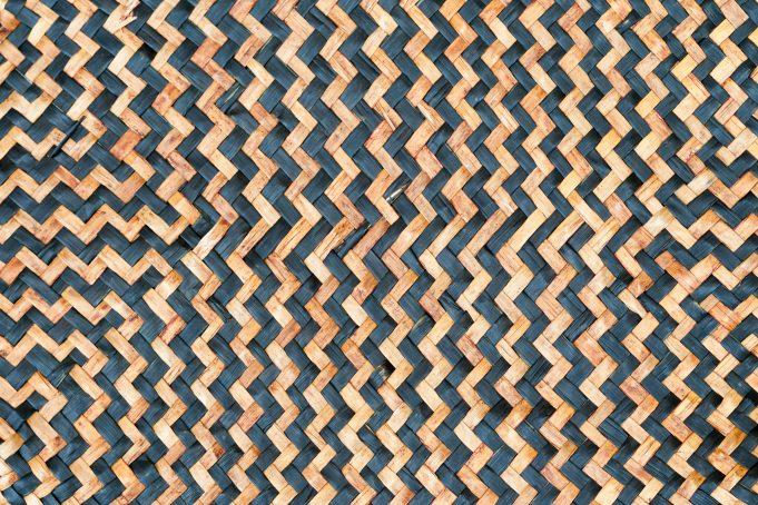 Tan woven leaf mat with black zig zag pattern