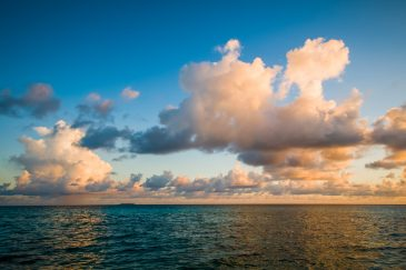 Tropical sea sunset clouds