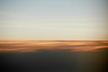 Vague sunrise projection on top of clouds
