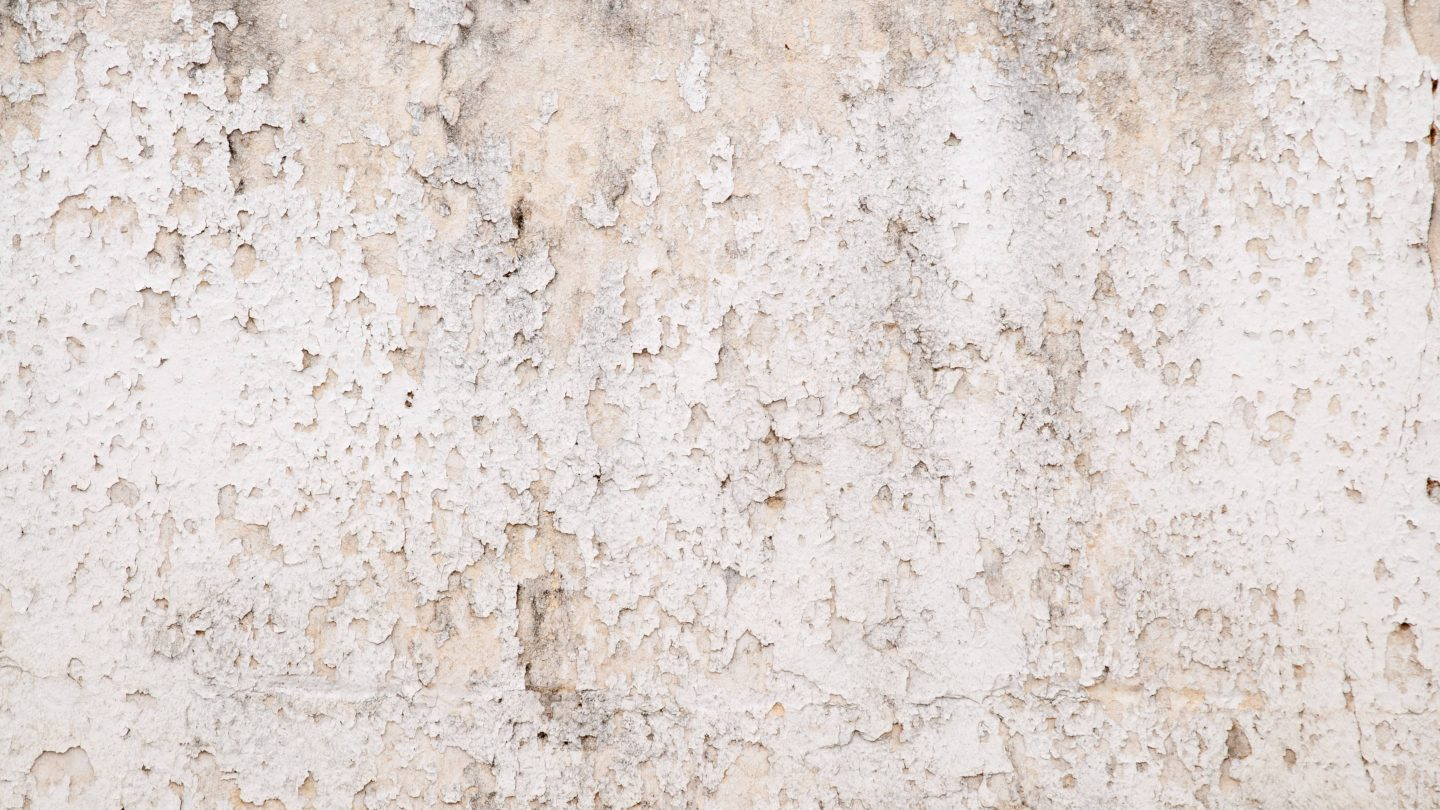 White subtle grunge wall texture with peeling paint