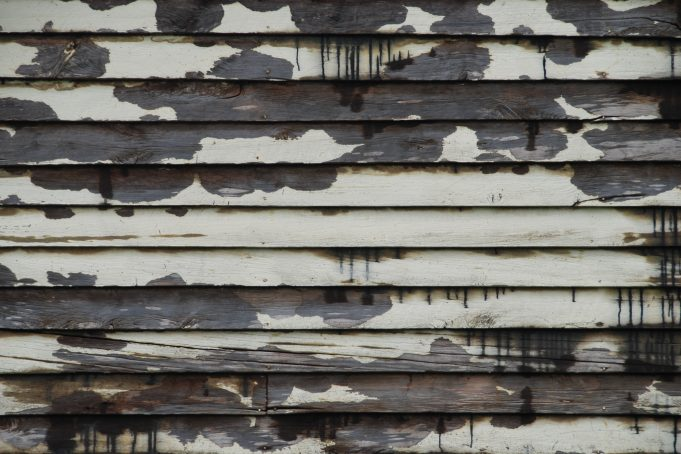 Wooden Panels with White Peeling Paint