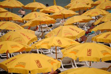 Yellow umbrellas on a sunny beach
