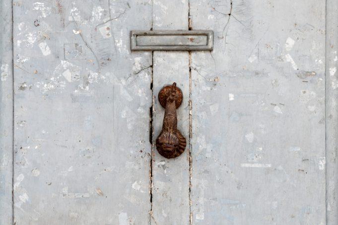 Metal door and rusty knob