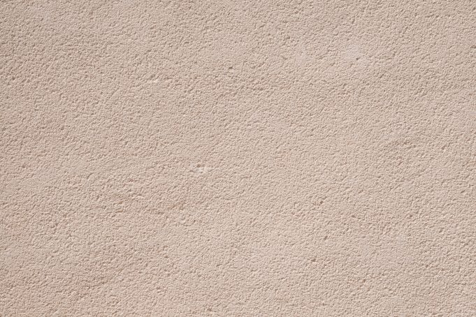 subtle grain plaster wall close-up