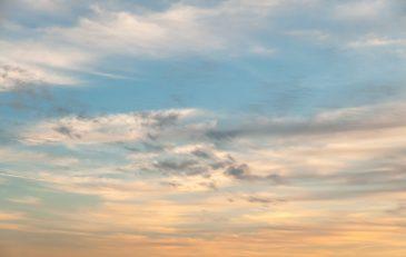 Subtle orange blue radient sunset sky
